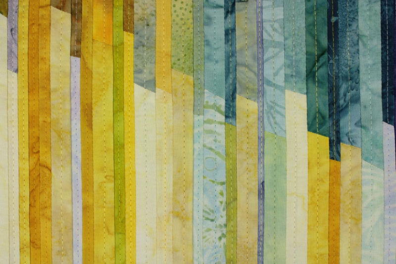Detail View of the art quilt Breathing Space highlighting the neatly pieced fabric strips
