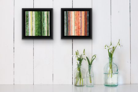 There Will Always Be Light #9 and 10 shown on a wall behind vases with flowers