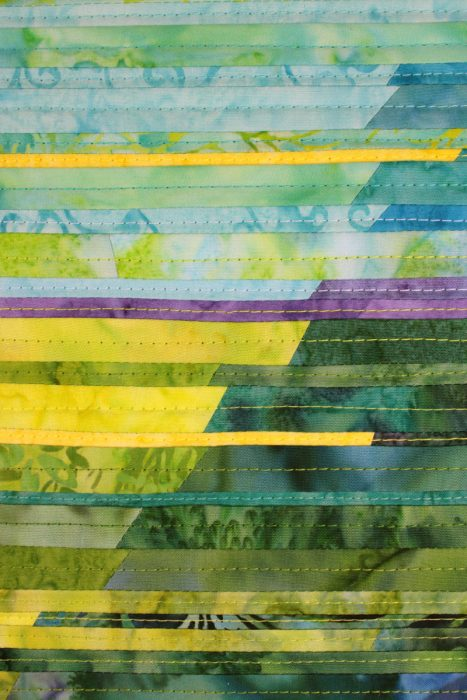 """The detail view of """"Finding Balance"""" shows the stitching lines of the art quilt"""